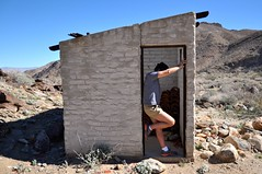 In the Middle of Nowhere (Blue Rave) Tags: 2015 back backside fedora bloke dude guy male mate people sexy legs thighs shorts mysterious shy hat desert mystery palmsprings meninshorts guysinshorts building california ca