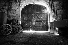 What is behind that door? (CHCaptures) Tags: door old blackandwhite abandoned monochrome austria tor schwarzweis michaelnbach sonyilce7 sel2470z