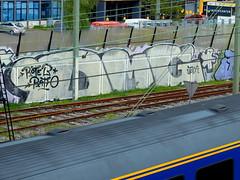 Graffiti Trackside (oerendhard1) Tags: urban streetart art graffiti rotterdam vandalism traintrack a20 ratio dmg trackside roteb