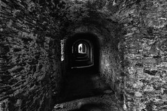 medieval streets (Georgie Pauwels) Tags: streets germany dark darkness candid streetphotography medieval stonewall walls passage passageway