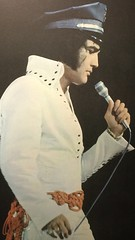 Policeman Elvis at the Forum in Inglewood, CA  1970. (rockinred1969) Tags: kingofrocknroll soldout karate blackbelt goodies oldie heartbreakhotel hounddog jumpsuit inglewood policehat elvisinconcert live inconcert 1970s rocknroll igotluckysuit 1970 laforum elvispresley presley elvis