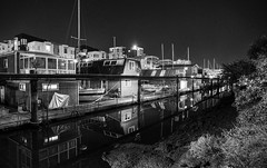 Tranquil city night (PeterThoeny) Tags: sanfrancisco 1xp selp1650 nex6 hdr photomatix california longexposure night clear lights gold golden houseboat water waterreflection reflection boat highrise city river creek missionbay architecture waterfront outdoor skyline monochrome blackandwhite fav200