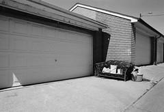 Couch (geowelch) Tags: toronto blackwhite 35mmfilm urbanlandscape pentaxmx urbanfragments xp2super400 rogersroad plustekopticfilm7400 pentaxtakumara28mm28