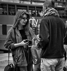 Give what you can! (Nikonsnapper) Tags: street bw candid olympus unposed zuiko collecting em1 75mm