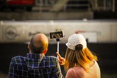 Selfie (C_MC_FL) Tags: vienna wien street people woman selfportrait man canon photography eos austria photo sterreich focus couple fotografie leute candid paar streetphotography smartphone mann rearview frau tamron personen selfie fokus donaukanal rckansicht 18270 60d b008 selfiestick