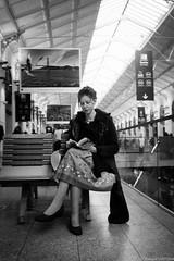 J'attends mon train (Maestr!0_0!) Tags: street urban white black paris station saint train reading xpro noir fuji gare candid rue blanc urbain lazare