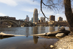 Minneapolis Minnesota Skyline (Lucie Maru) Tags: city bridge urban cold building water minnesota skyline river landscape spring midwest skyscrapers minneapolis dry driftwood mississippiriver lowwater buidings archticture dryspring mississippir woodfloatinginwater