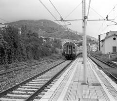 Train Approaching Letojanni (Julian Dyer) Tags: travel italy travelling blackwhite sicily taormina ilforddelta400 filmphotography ilfordddx fujigf670