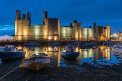'Quayside Twilight' - Caernarfon Castle (Kristofer Williams) Tags: sea urban castle water wales night landscape boats twilight lowlight nightscape dusk quay yachts floodlit caernarfon