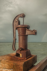 Withered but Working (jeeprider) Tags: pier fishing gulf florida rusty pump rainbows withered crusty