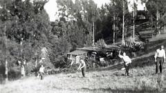 Pitching Horseshoes (jhitzeman) Tags: trees game men hillside horseshoes 629v