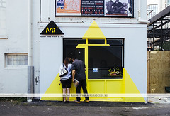 Mi - Fusion Food - Auckland, NZ (Naomi Rahim (thanks for 2 million hits)) Tags: city travel newzealand summer urban window sign yellow wall architecture cafe nikon triangle paint wanderlust auckland nz northisland 2015 travelphotography nikond7000