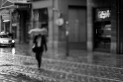 Singing in the rain (Mathieu Thiebaut   http://www.mathieuthiebaut.com) Tags: street shadow blackandwhite bw abstract france monochrome rain french photo noiretblanc outdoor strasse pluie pic nb ombre strasbourg explore amateur strabe photoderue hcsp streetpic