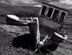 Abandoned Boats (rustyruth1959) Tags: bw abandoned beach boats mono nikon isleofskye outdoor rope hills loch nikkor wreck damaged fishingboat carbost lochharport nikond3200 canydon