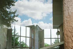 Window (JacksonSwaby) Tags: blue trees light sky cloud reflection building tree window nature glass stone clouds exterior interior pillar structure