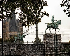Equestrian statue of Emperor Wilhelm II at the Hohenzollern bridge in Cologne, Germany (PhotosToArtByMike) Tags: hohenzollernbridge rhineriver colognegermany greatstmartinchurch emperorwilhelmii equestrianstatue cologne germany dom koln rail railway klnerdom oldtown oldquarterofcologne europe