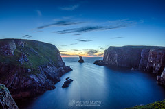 Port Challa Tory Island (mythicalireland) Tags: ocean sea sky cliff clouds port mouth landscape island bay twilight harbour cliffs stack atlantic midnight bluehour donegal tory afterglow challa