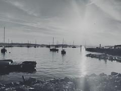 Reaching out (nitikajo_) Tags: summer vacation sun mountains burlington boats rocks vermont child boardwalk kayaks