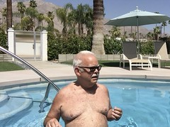 Enjoying the summer sun. (SFBart in Palm Springs) Tags: 3000views denudoscompletamente autoretrato hairychest palmsprings mature nude shirtless pool sfbart
