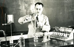 Professor Donovan Courville pours a liquid (PUC Special Collections) Tags: laboratory lab pacificunioncollege chemistrydepartment chemistrylab chemistry beakers test tubes scientist labcoat experiments angwin california adventist sda seventhdayadventist college