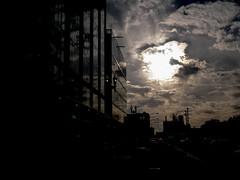 The Dark On The Glass (Romain Talgorn) Tags: cloud sun chicago building glass us