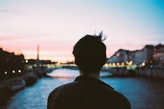 Heartfelt (Louis Dazy) Tags: city boy sunset sky man blur paris seine youth clouds analog sunrise 35mm la nikon focus bokeh young thoughtful 100 f2 manual pushed selective ektar