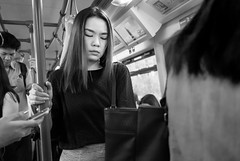 Woman in BTS Skytrain, Bangkok (tord_remme) Tags: street travel bw woman white black monochrome beauty train asian thailand blackwhite model asia natural noiretblanc bangkok candid streetphoto ethnic bnw greyscale blancetnoir nopose