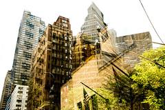 Gotham (petertandlund) Tags: street city nyc urban newyork color skyline architecture skyscraper buildings doubleexposure flag redlight multiexposure xe1 fujix