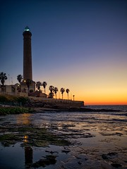 Lighthouse Chipiona (dubdream) Tags: chipiona andaluca espaa spain lighthouse leuchtturm aftersunset sky seascape sea atlantic atlntico architecture colorimage wetreflection lowtide palm palmeras house beach dubdream olympus