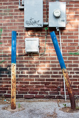 Day 246: Behind a building on Grand (allankcrain) Tags: wall pole brickwall barrier poles meter bent junctionbox electricalmeter