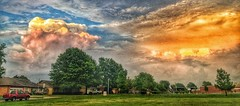 Storm chaser (Pejasar) Tags: storm remainsoftheday sunreflections green trees redpickup grass clouds sky free blue orange