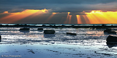 Through the Clouds (renatonovi1) Tags: sunrise sun rays clouds light water sea ocean beach nature seascape landscape rocks longreef sydney nsw australia
