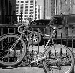 Student Driver (christait) Tags: blackandwhite bw canada calgary bike bicycle downtown hasselblad alberta fixedgear bumpersticker yyc studentdriver ilforddelta3200 500cm fixy rodinal1100stand2hrs