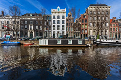 Herengracht splendour (McQuaide Photography) Tags: city windows urban holland colour reflection building water netherlands colors amsterdam architecture canon boot eos boat canal spring europe colours afternoon dynamic bright availablelight vibrant nederland houseboat naturallight wideangle bluesky ramen handheld daytime blueskies colourful fullframe dslr residential 1740mm stad raam herengracht gebouw gracht kleurrijk lightroom middag 6d kleur venster canalhouse steadyhands lseries woonboot grachtenpand groothoek canon6d mcquaidephotography