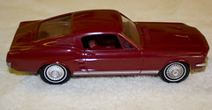 1967 Ford Mustang GT Fastback Promo Model Car - Candy Apple Red (coconv) Tags: pictures auto old red history classic cars ford apple scale car vintage toy 22 miniature photo promo model automobile candy image photos muscle antique picture images plastic 124 vehicles photographs photograph sample 1967 vehicle historical kit autos mustang collectible gt collectors promotional coupe 67 automobiles dealership johan dealer mpc 125 amt fastback smp hubley revell 125th banthrico