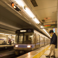 nagoya-1884-ps-w (pw-pix) Tags: people signs man motion blur station japan wall standing train underground subway lights moving movement waiting phone platform tracks railwaystation signals tiles trainstation nagoya driver passenger leaning tiled lookingatphone