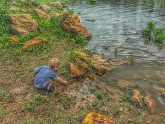 Lakeside discoveries (Pejasar) Tags: boy child play discovery exploration coen rocks water keystonelake