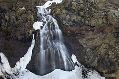 and yet another waterfall near the road (lunaryuna) Tags: longexposure snow ice nature water beauty season landscape waterfall iceland spring rockface le lunaryuna centralhighlands naturaltextures seasonalchange
