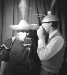 Early use of an e-cigarette (theirhistory) Tags: man hat person idea idiot cigarette experiment smoking indoors madness mad wat