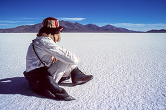 Salt Lake Sitty (Dan Thory) Tags: travel white mountain mountains southamerica look female relax landscape outdoors alone sitting quiet peace looking flat adult outdoor think relaxing calming peaceful dry bolivia tourist calm traveller adventure backpacking salty future sit thinking remote backpacker barren contemplate arid tranquil sits contemplating altiplano highaltitude uyuni caucasian salts adventurous lookingforward remoteness