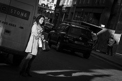 A Gap In The Traffic (Leanne Boulton) Tags: life street city uk light shadow people urban blackandwhite bw woman sunlight white black detail texture girl face look female danger canon 50mm mono scotland living blackwhite pretty crossing shadows natural emotion humanity outdoor expression glasgow candid young culture streetphotography streetlife scene human shade 7d feeling shadowplay society depth tone facial candidstreetphotography