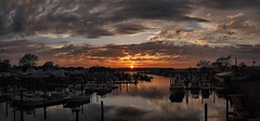 Harbor Sunset Panorama (markchevy) Tags: pink sunset sea orange storm reflection clouds docks landscape boats bay harbor photo newjersey interesting colorful pix graphic dusk nj picture scene atlantic vista belmar avon pictorial sharkriverinlet epl1 markchevy