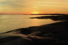 Sunset behind the harbour (emskisee) Tags: sunset sea orange nature water rock canon suomi finland landscape coast kallio outdoor smooth peaceful balticsea canoneos itmeri auringonlasku pori ndfilter kallo mntyluoto