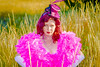 Saloon Girl Gone Bad-02 (eriknorderphotography) Tags: pink newzealand christchurch outdoors flash feathers psychodelic burlesqueperformer sony70200f28g sonyalpha550