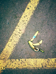 Banana peel, KS parking lot 3/13/15 (f l a m i n g o) Tags: march pavement ground banana peel friday 13 13th app iphone 2015