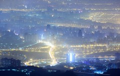 Lighting City ~ Aerial  Night  View of  Taipei city @ The Tough guy Ridge  ~ (PS~~) Tags: city travel blue light sky urban bali panorama mountain mountains color reflection fog skyline architecture port canon buildings dark stars landscape photography evening office high twilight haze downtown ray cityscape exterior dusk top famous taiwan vessel landmark scene business galaxy fantasy moonlight nightscene     riverview valleyview tamsui cityview yangmingshannationalpark  densefog    tamsuiriver   guanyinmountain   advection taiwanimage  mists