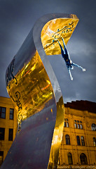 Night Reflections (clickclickphotographyuk) Tags: street light sculpture man color colour statue metal night canon reflections dark lens fan vibrant steel low dramatic kitlens falling hanging kit copyrightaaronjcollyer2015