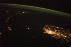 Two Koreas, One Bright, One Not (sjrankin) Tags: china russia edited nasa seoul citylights southkorea iss rok northkorea pyongyang dprk seaofjapan koreanpeninsula earthslimb iss043 iss043e40317 31march2015