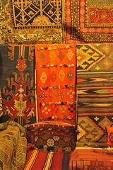 Vibrant Traditional Textiles Al-Madina Souk An Afternoon in Aleppo, The Ancient City that Was October 31 2010 Syria Middle East (eriagn) Tags: travel art history tourism wool rock fruit architecture concrete religious photography wooden traffic citadel minaret traditional prayer religion middleeast streetphotography documentary mosque tourist tourists unescoworldheritagesite traveller textures syria souk historical produce bazaar dailylife textiles fortification moat fortress weaving income citizens aleppo hawkers syrian bathhouse suq shopkeeper marked beliefs ngaire ancientcity umayyadmosque orientalrugs camelhair medievalbuilding ceilingdecoration oldwalledcity citadelofaleppo traditionaltextiles eriagn ngairehart almadinasouq syrianstreetfood mpsqueinterior syrianpostbox
