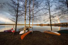 Rainbow, boats and birches (- David Olsson -) Tags: trees mars lake water landscape boats march pier nikon sweden jetty canoe karlstad handheld fx lifebuoy vr birches lifering d800 brygga vrmland 1635 2016 1635mm kroppkrrssjn davidolsson kroppkrrsjn 1635vr korppkrr